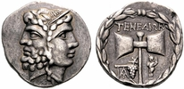 This coin is not Archaic--it dates from BC 188-170 (the Hellenic Period, I think?) according to the website I took the image from.  But even at this later date, you can still see the axe with a bunch of grapes underneath it displayed as symbols of the island.